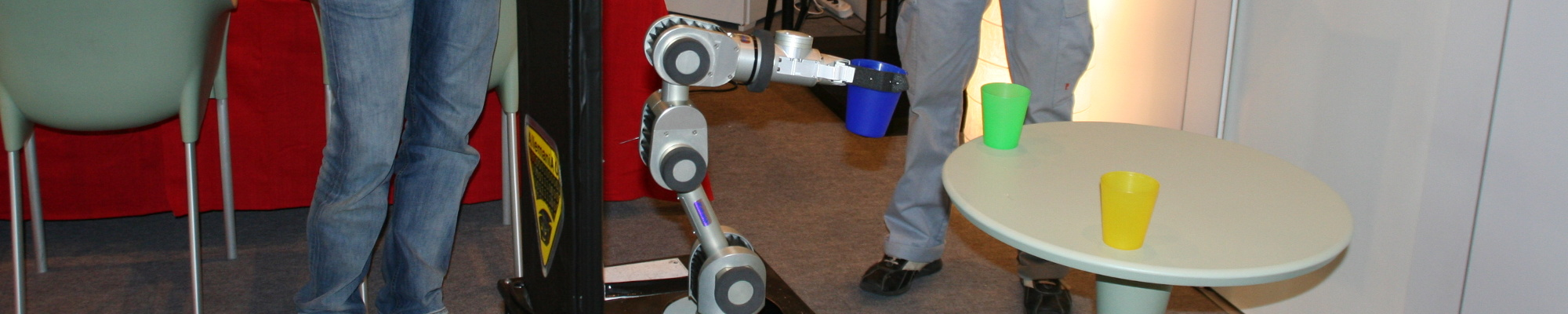 Robot after successfully grasping a cup (Hannover 2007)